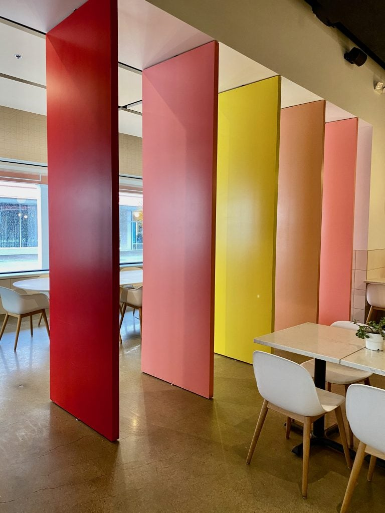 rainbow panels as room dividers at Caffetteria