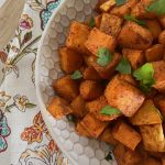 close shot of roasted sweet potatoes with parsley
